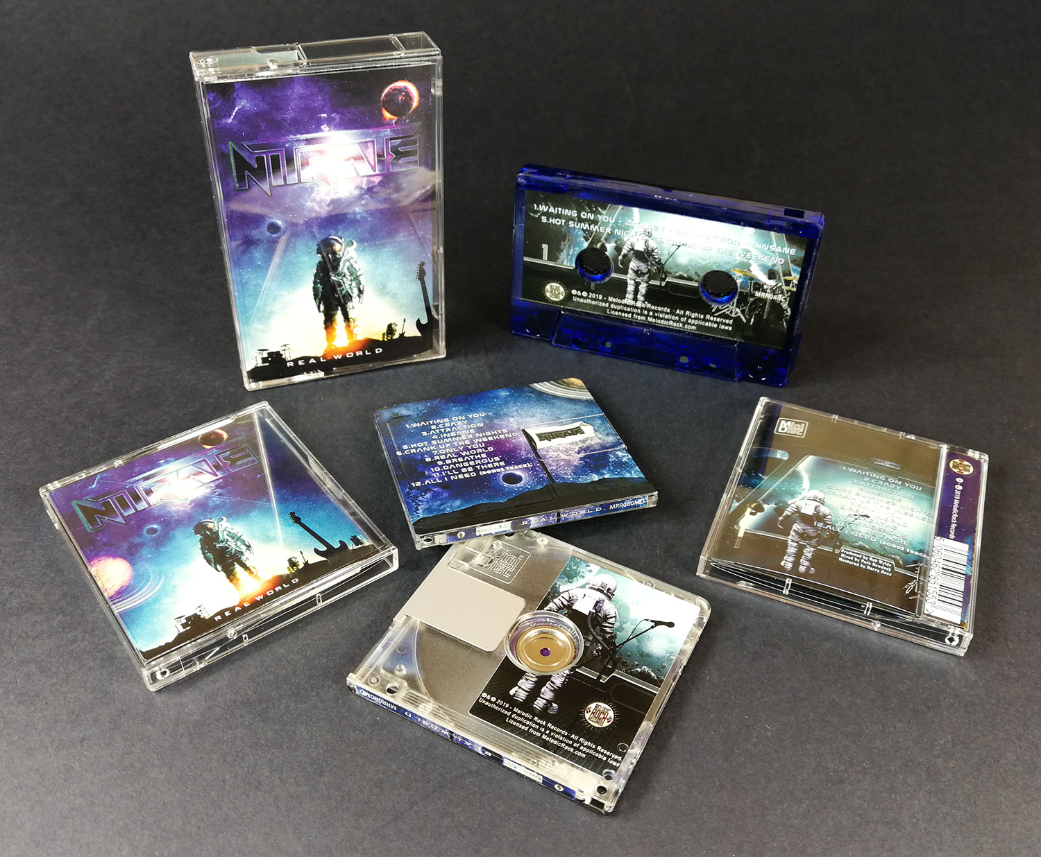 Transparent blue cassette tapes and matching MiniDisc sets