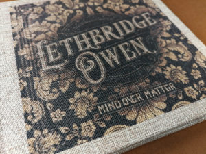 Full colour cover printing on a light brown coarse linen digipak