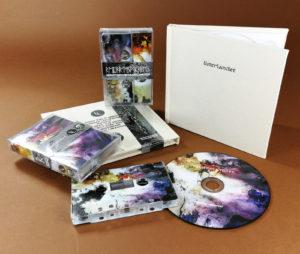 Full coverage on-body print cassette tapes and CDs in hardback cream linen fabric digipacks