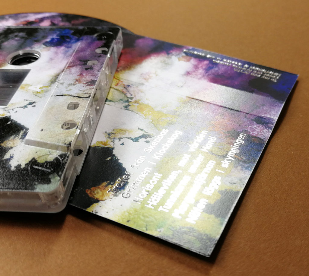 Silver metallic foil printing over a full colour cassette tape J-card print