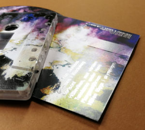 Silver metallic foil printing over a full colour cassette tape J-card print