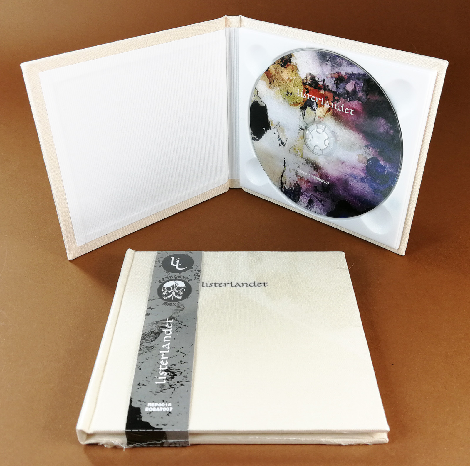 UV-LED printed CDs in hardback cream linen fabric digipacks with an obi strip