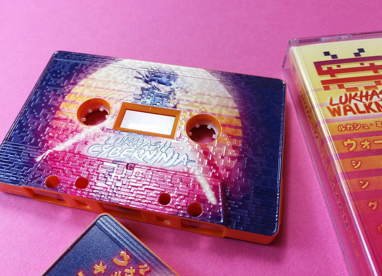 Tangerine orange cassettes with full coverage, full colour printing with a full coverage spot gloss finish
