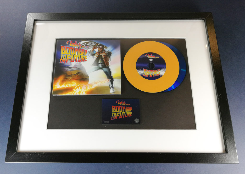 Custom vinyl CDs with orange vinyl rings on a blue base disc for a 'Back to the Future' style release in one of our oversize A4 frames