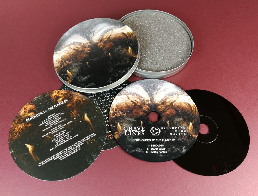CD tins with full colour lid and base printing, plus two circular printed card inserts and UV-LED printed black base discs