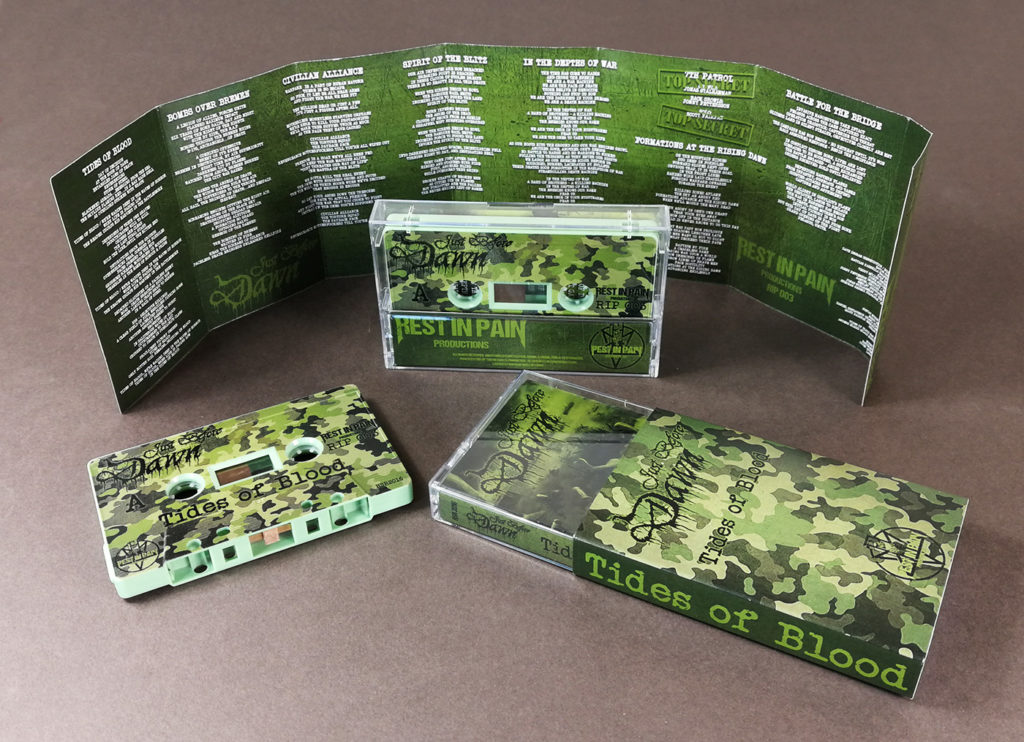 Sage green cassettes with full coverage on-body UV-LED printing and J-cards with five extra fold-out panels, plus outer O-cards over the cases