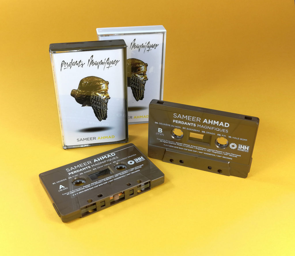 Vintage bronze cassette tapes with white on-body printing in gold and white cassette cases with clear front windows