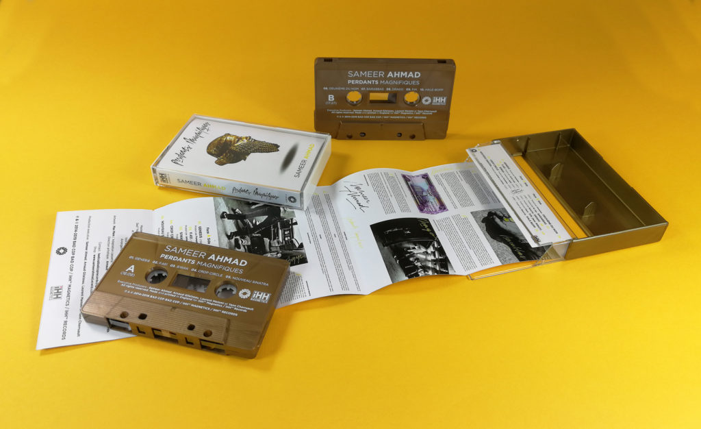 Vintage bronze cassette tapes with white on-body printing in gold cassette cases with clear front windows