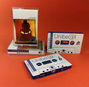 Dark blue cassette tapes with full colour on-body UV-LED printing in cases with J-cards