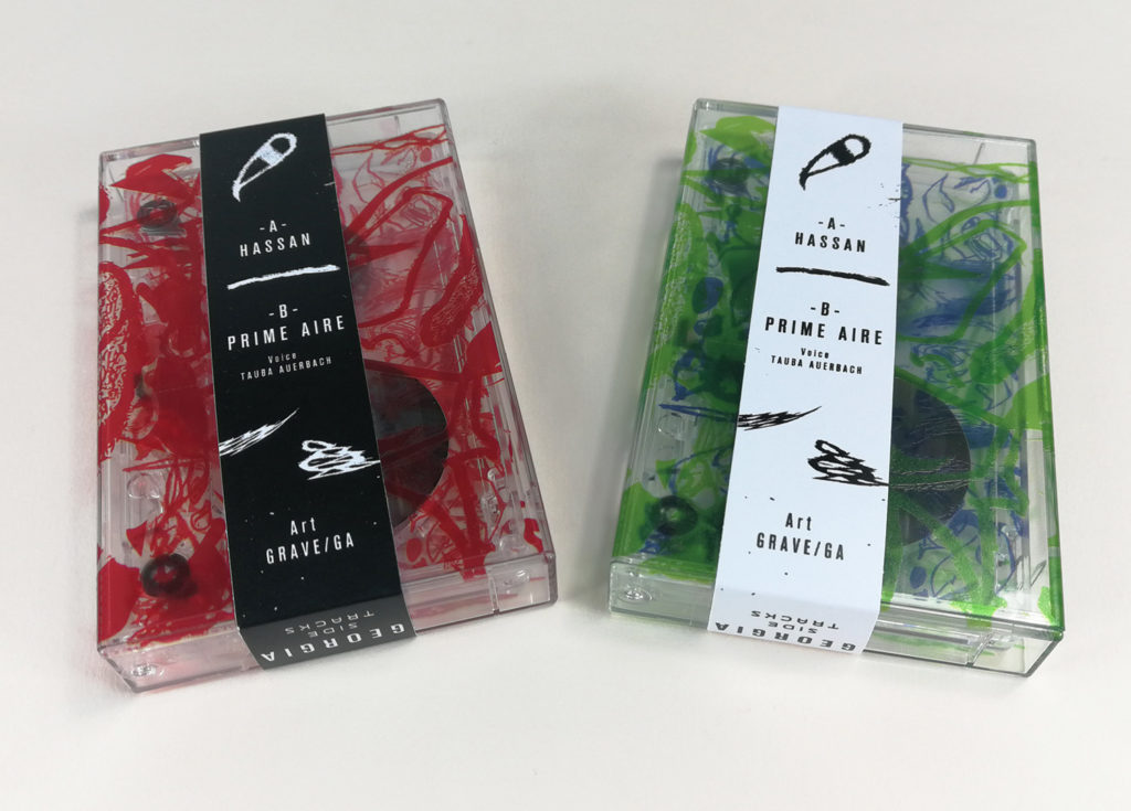 On-body printed cassettes in clear cases with full colour on-body printing and obi strips added