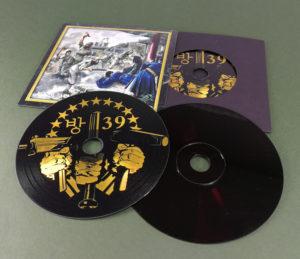 Custom printed full coverage black vinyl CDs with a metallic gold print in premium vinyl wallets