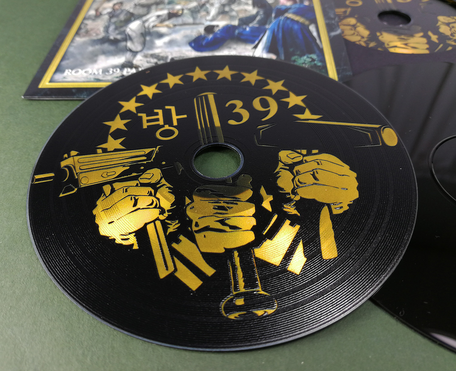 Custom printed full coverage black vinyl CDs with a metallic gold print in premium vinyl wallets