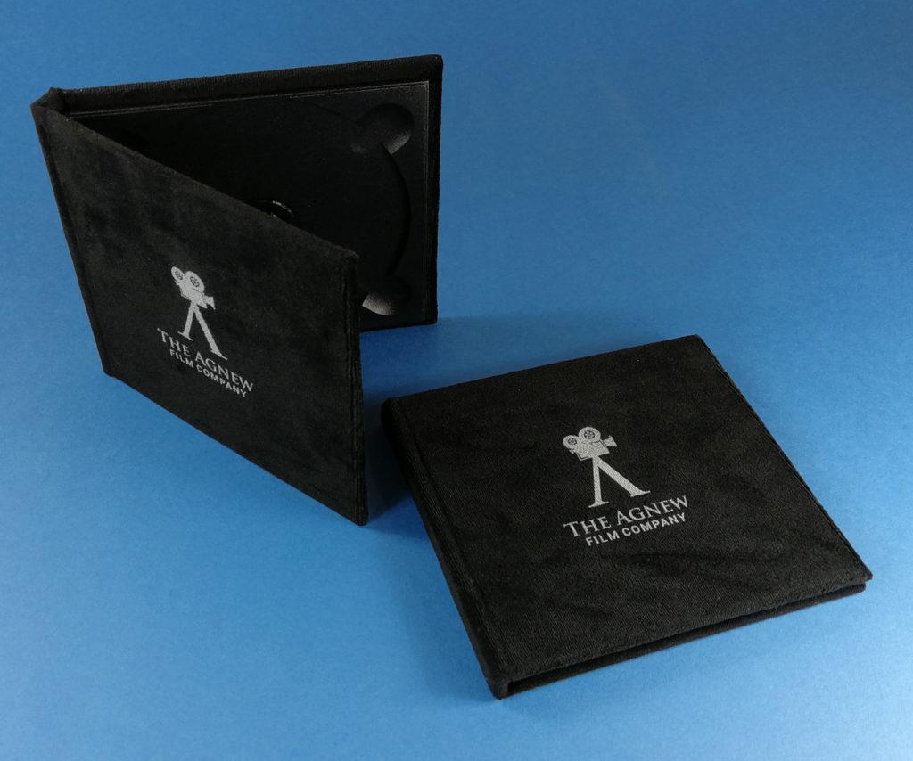 Black velvet hardback digipaks with a white UV-LED print