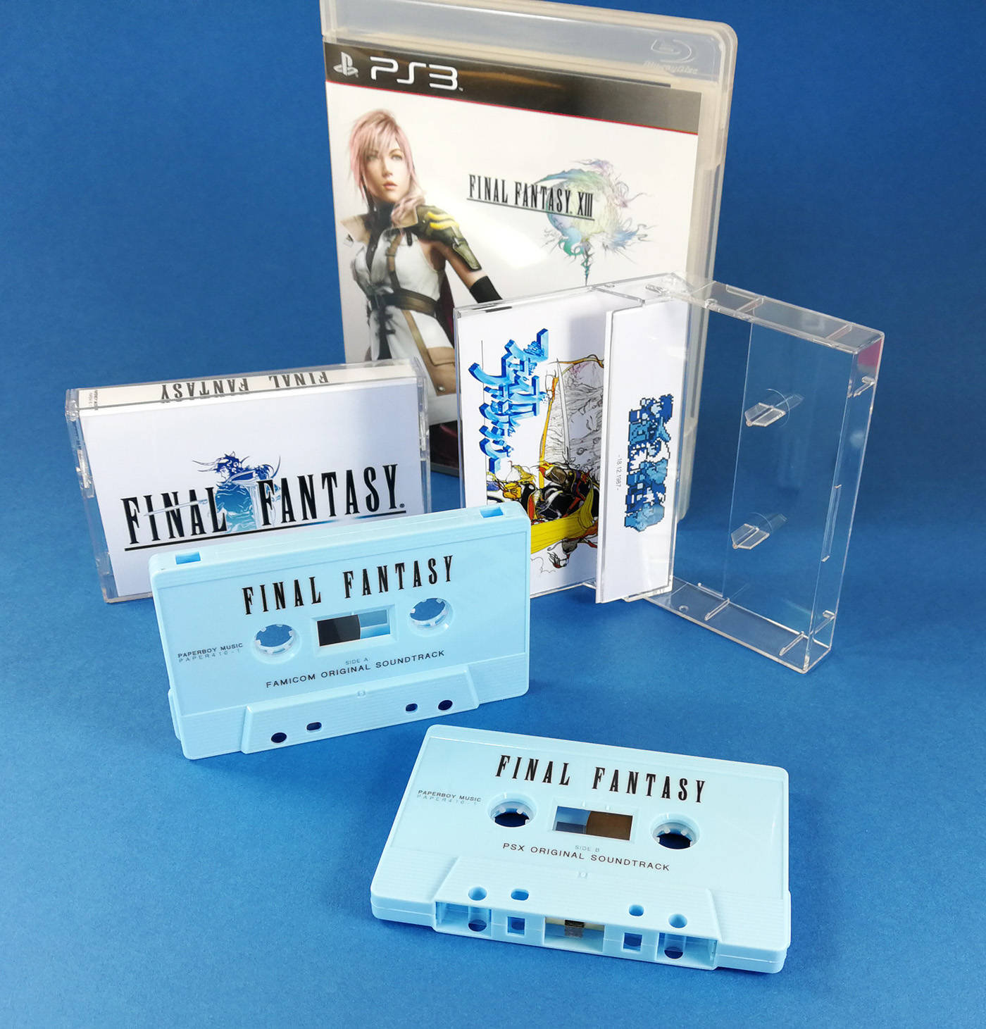 Sky blue cassette tapes with black on-body printing and printed J-cards