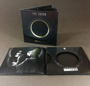 4 page double CD wallets with gold foil cover printing and a booklet glued into the inner left cover