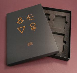 Copper metallic foil printing on a black A4 quad cassette tape presentation box