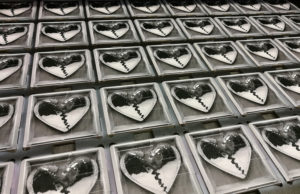 Mark Ronson MiniDiscs in the on-body printing jig on our UV-LED printer