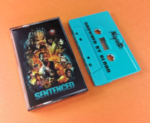 Sentenced 'Drowned by Blood' turquoise cassette tapes with a Predator themed J-card