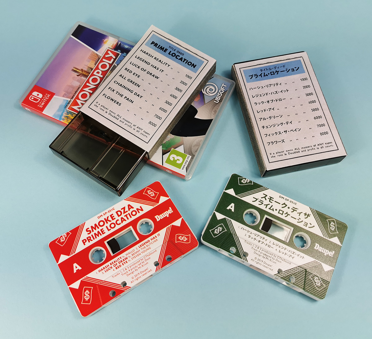 Monopoly-style outer cassette case O-cards for the English and Japanese versions of these tapes