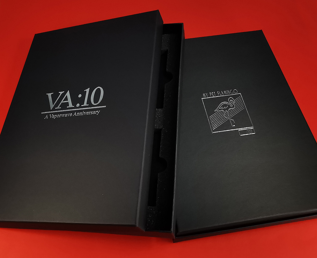 Black A4 presentation box for four cassette tapes with silver foil lid and base printing