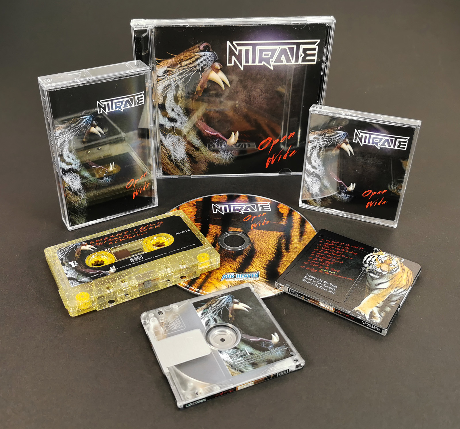 Gold glitter cassettes and MiniDiscs produced for Nitrate and their 'Open Wide' album