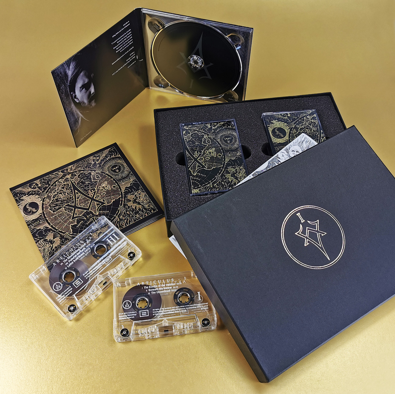 CD digipaks and matching twin cassette tapes in presentation boxes with gold foil printed lids