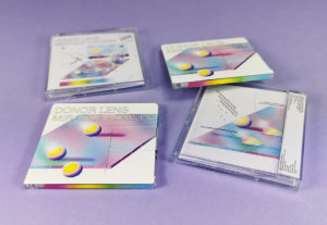 Clear MiniDiscs with colourful on-body spine and top printing, packed in jewel cases with J-cards
