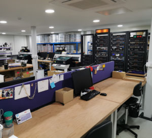 Main production area showing the tape decks and two Mimaki UV-LED printers