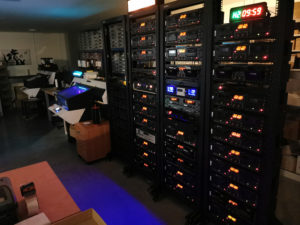 Tape recording decks and one Mimaki UV-LED printer in use at night