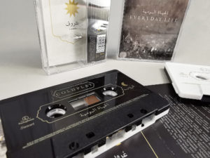 Black and white sandwich tapes with gold on-body printing and a spot gloss over the gold printing