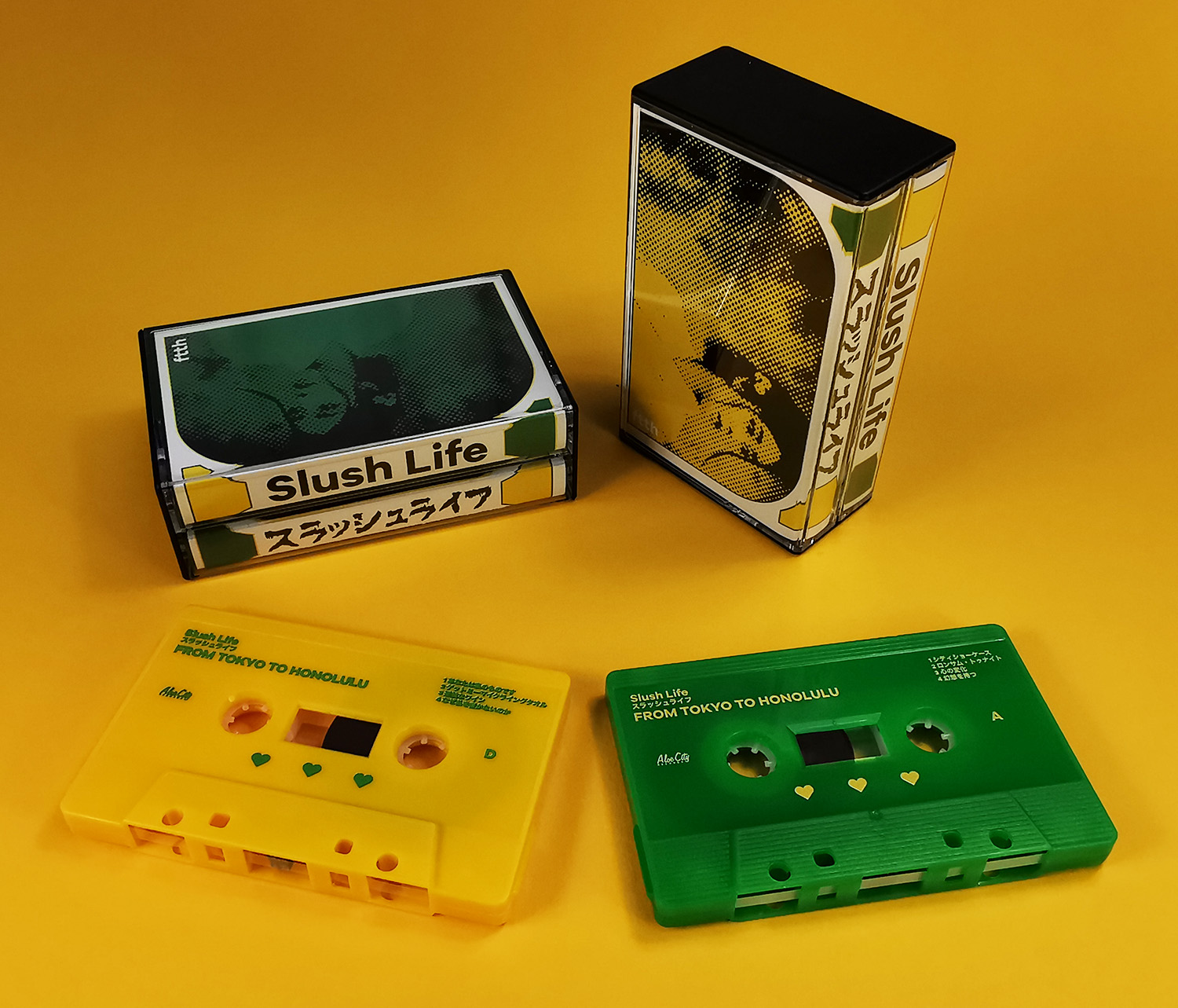Double butterfly cassette tape set with yellow and green tape shells with on-body printing