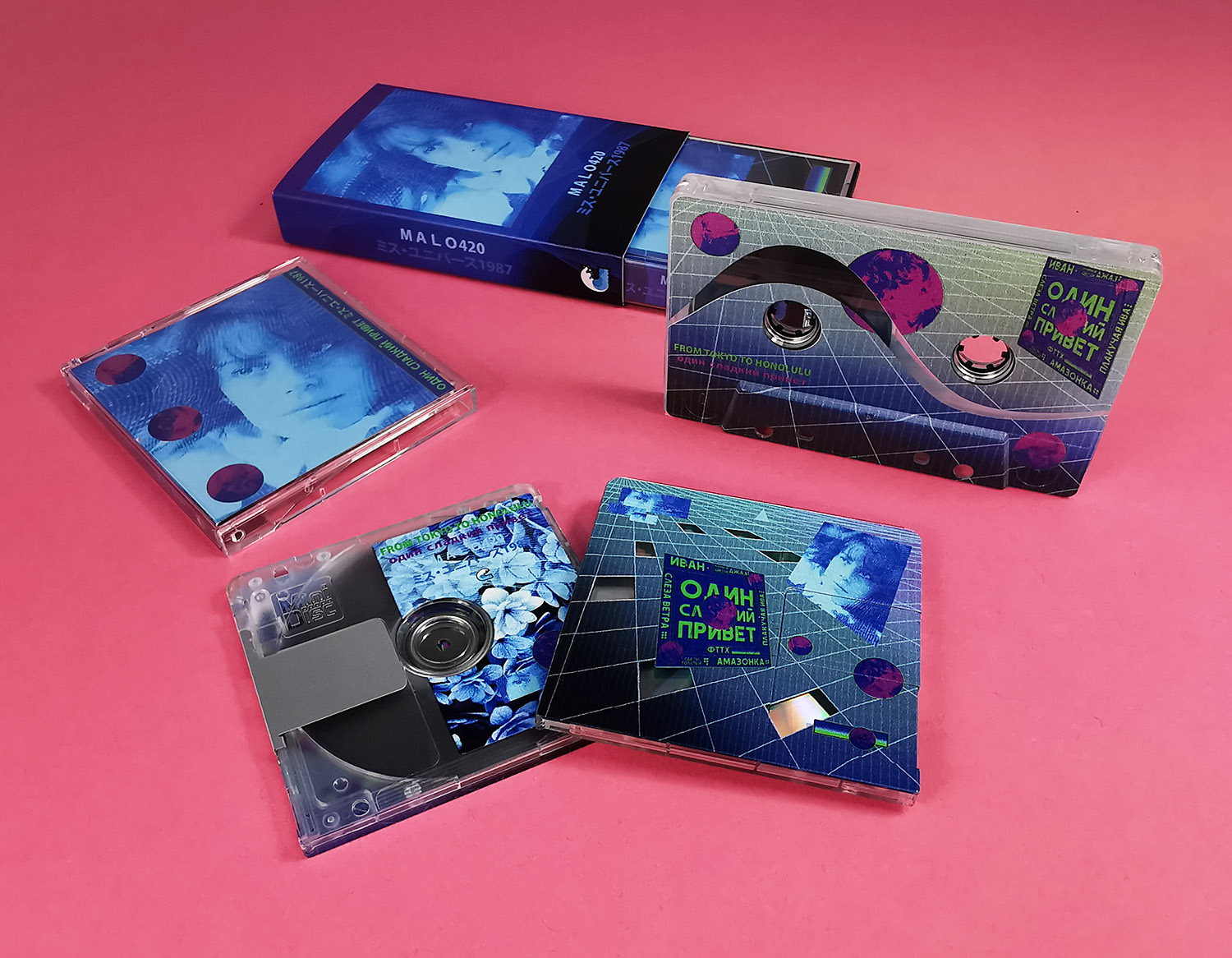 Matching cassette tape and MiniDisc set with partial reveals of the clear tapes and MiniDiscs underneath