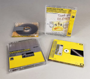 MiniDiscs with full coverage top and spine printing, packed in clear jewel cases with double sided J-cards