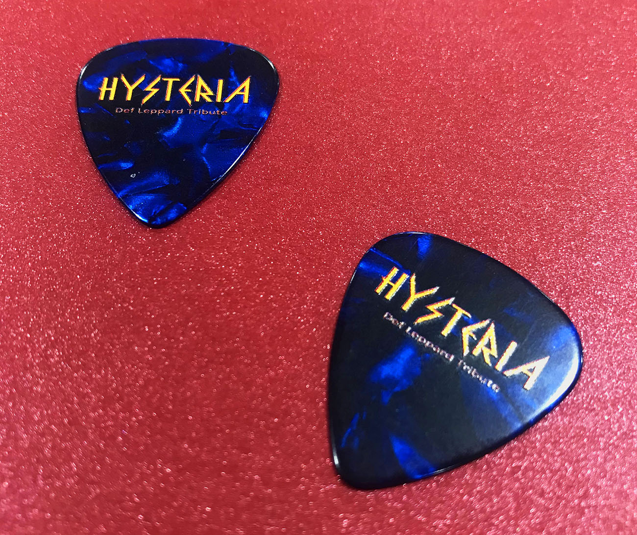 Dark blue guitar picks with full colour printing onto a white base