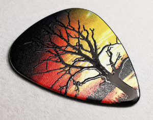 Black guitar pick with full colour printing and a clear spot gloss over the tree