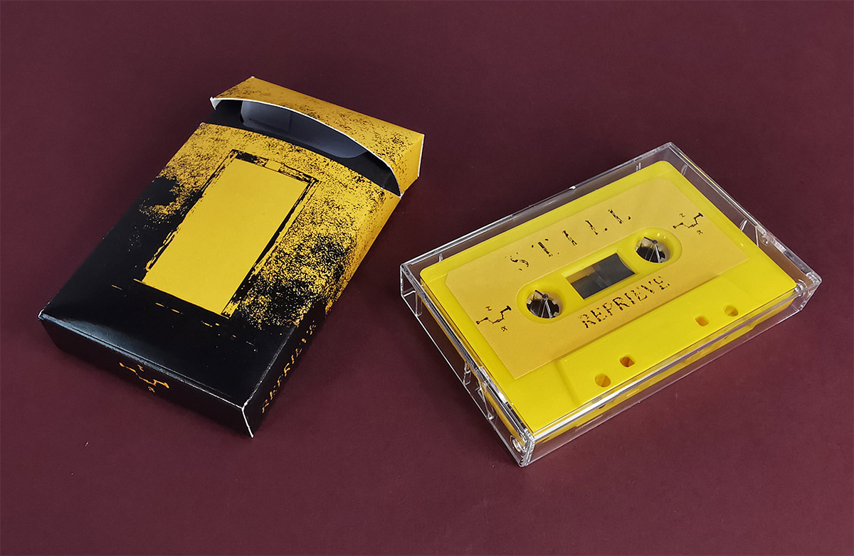 Yellow cassette tapes in clear cases, packed in our cigarette-style outer cases with black inner inserts