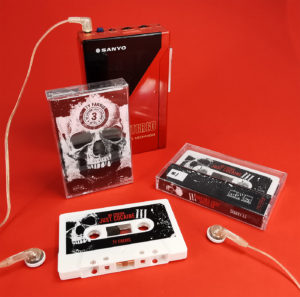 White cassette tapes with full colour sticker printing and J-cards in clear cases