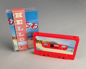 Neon pink cassettes with full colour sticker printing, J-cards, clear cases and outer vertical obi strips