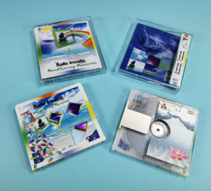 MiniDiscs with partial white and colour front prints to reveal a section of the MiniDisc