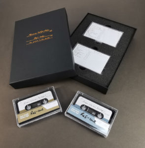 A double cassette box set in an A5 black preentation box with copper hot foil lid printing