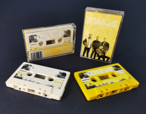 Cream and yellow cassette tapes produced for All Time Low and their 'Wake Up Sunshine' release on Warner Records