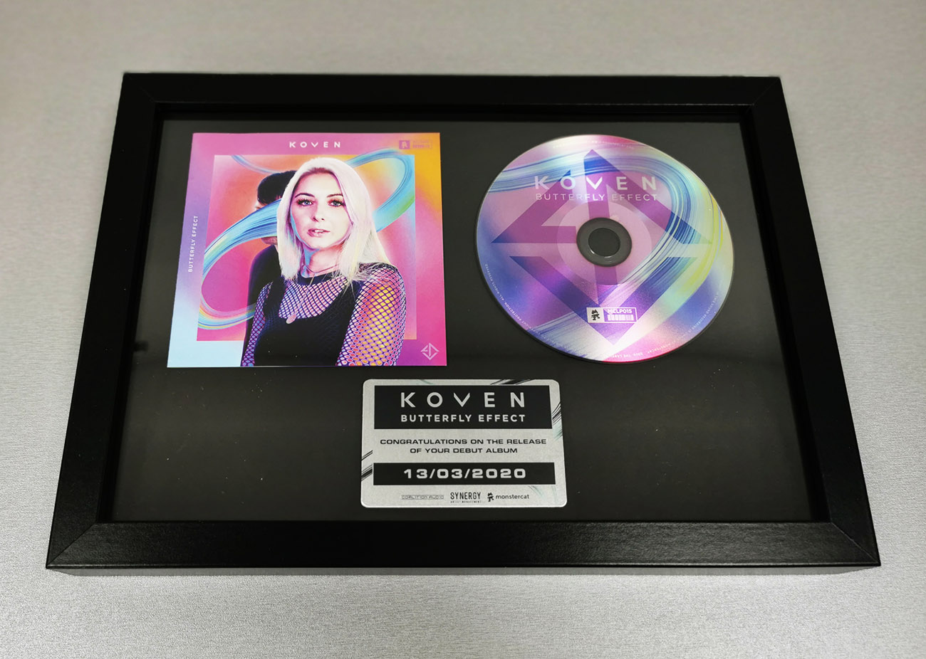Black A4 frame with printed metal plaque, CD and booklet