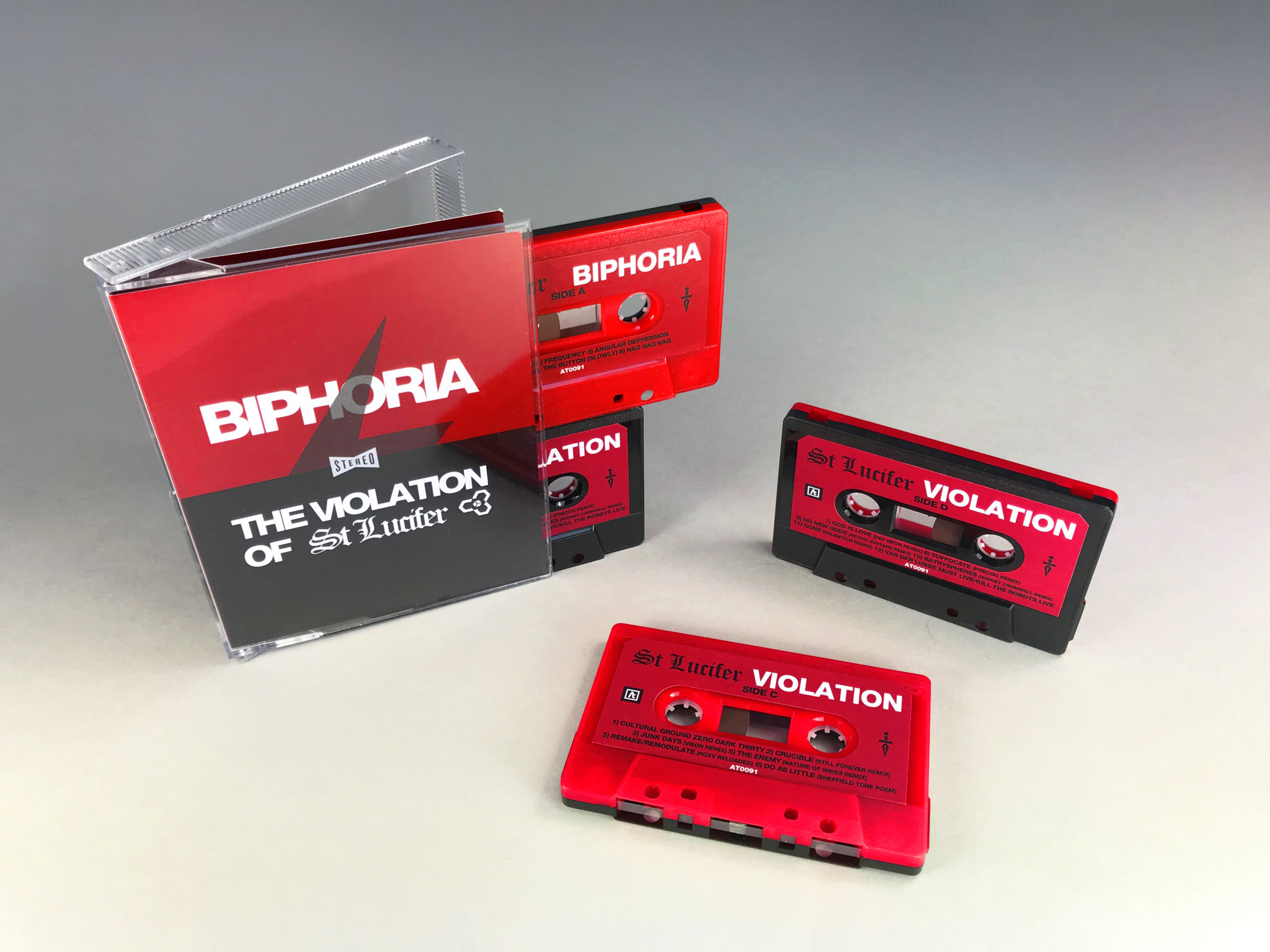 A double red and black sandwich-style cassette set in a tall stacked double case