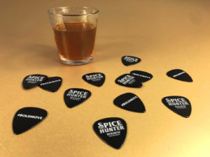 Black guitar picks with full colour printing, produced for Spice Hunter rum