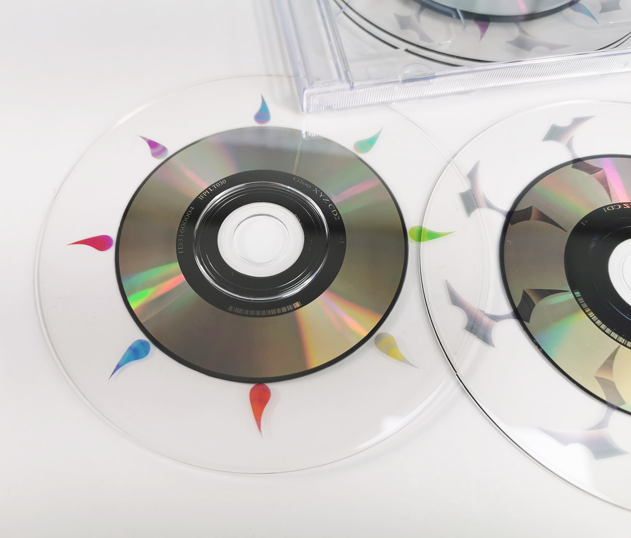 A double CD set with two full size 12cm CDs that only have an 8cm data ring and clear plastic outside
