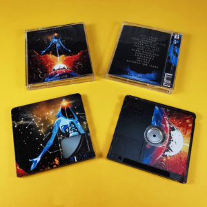 Transparent MiniDiscs with a full coverage black print to colour the discs and then full colour art overlaid