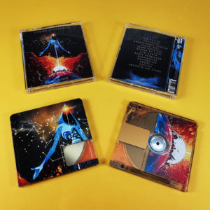 Transparent MiniDiscs with a full coverage orange print to colour the discs and then full colour art overlaid