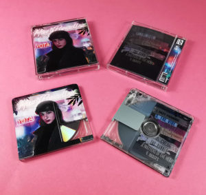 Printed MiniDiscs with a clear window under the clip area, supplied in a printed case