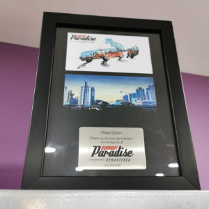 Burnout Paradise development team award frames with custom printed backgrounds and plaques