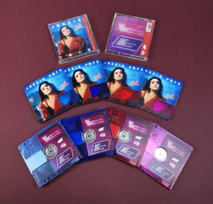 Clear transparent MiniDiscs, printed with light blue, dark blue, red and pink tints and full colour artwork